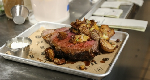 The prime rib is sliced to order and served with salt & vinegar potatoes and creamy horseradish dipping sauce.