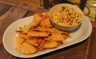 This cheesy street corn dip and fresh fried tortilla chips is addicting af