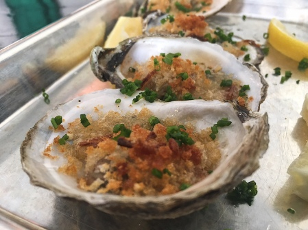 Roasted oysters with lemon, shallot, panko, and parm