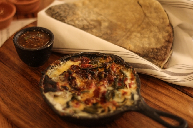 Queso fundido! Oh, make sure you add chorizo. Cheesy, porky goodness to pile on those hybrid blue/yellow corn tortillas.